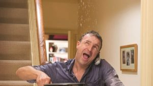 Man getting wet from upstairs leak